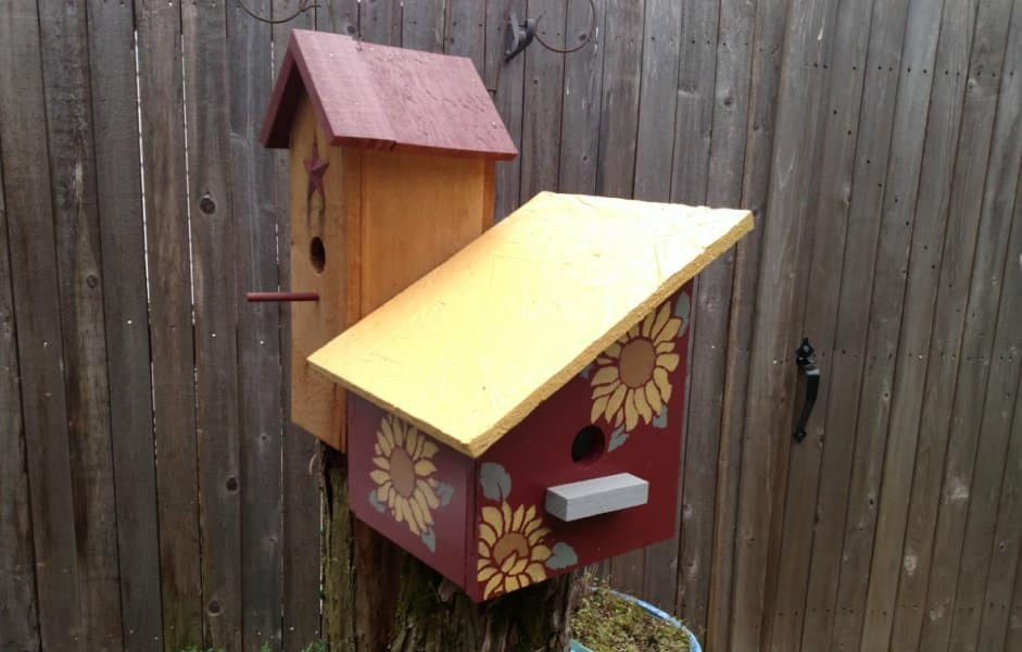 two brightly painted bird houses