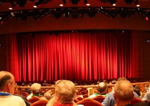 Color photo red curtain and audience in theater