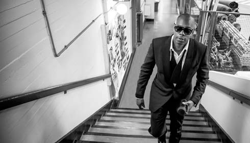 Black and white photo of comedian Dave Chappelle