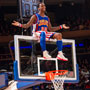 Photo of Harlem Globetrotter wearing blue and orange uniform sitting on basketball back board