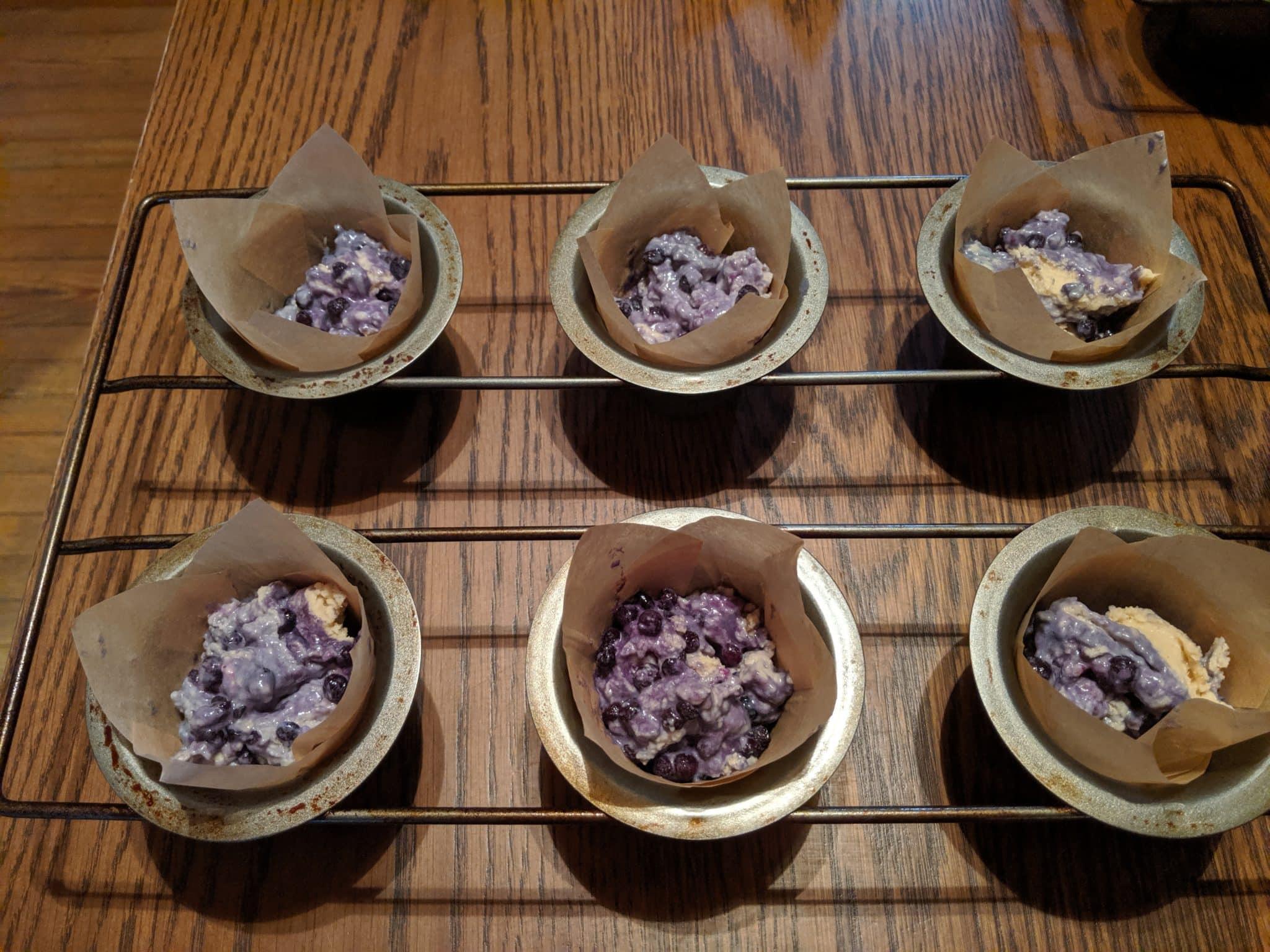 muffin batter in baking tin