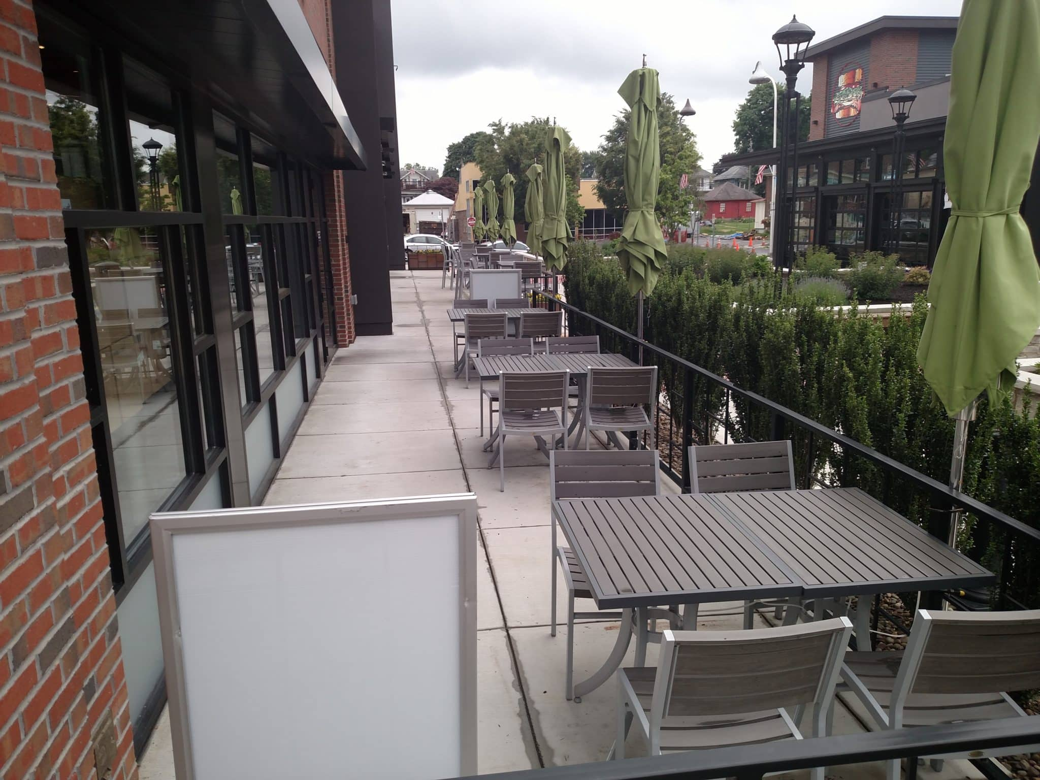 outdoor dining area showing tables with umbrellas