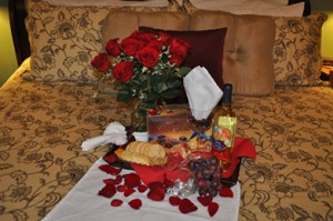 Bed with flowers, candy, cheese and crackers for Love is in The Air Package