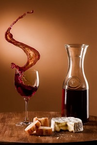 Beautiful photo of a carafe and wine glass with cheese and bread
