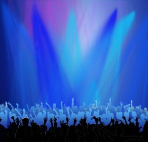 Image of crowd at a concert in blue and purple