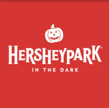 Hersheypark In The Dark logo on bright orange background with smiling pumpkin