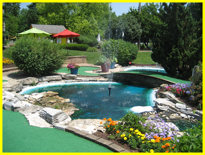 Photo of landscaped miniature golf course at Challenge Family Fun Center with fountains and plants