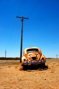 Color photo of old rusted Volkswagon