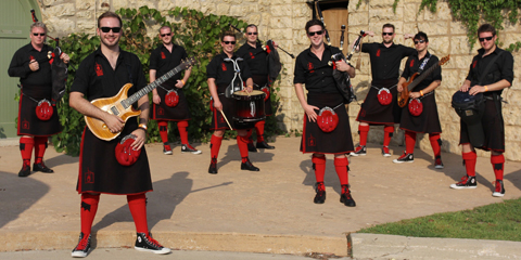 Photo of Red Hot Chili Pipers in kilts, red knee socks and sunglasses