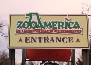 Entrance sign to Zoo America, beige with green lettering and a bird depicted